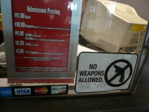 AMC Theatres: No Weapons Allowed, Courtesy of gruntzooki via Flickr